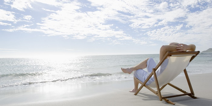 Man in lounge chair on beach
